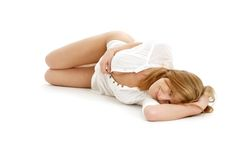 Lovely girl laying on the floor Stock Photos