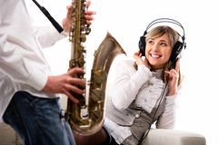 Lovely girl listening music Royalty Free Stock Photography