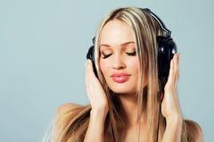 Lovely girl listening a music Stock Image