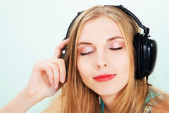 Lovely girl listening a music stock photography