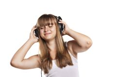 Lovely girl listening a music in headphones Royalty Free Stock Photos