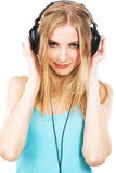 Lovely girl listening a music in headphones Stock Photos