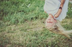 Lovely girl with long hair up side down stock image