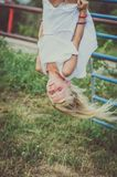 Lovely girl with long hair up side down royalty free stock image
