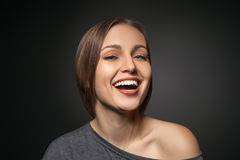 Lovely girl looking at camera with a wide smile Stock Photography