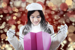 Lovely girl looking at christmas surprise Stock Photo