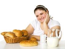 Lovely girl loving rolls Stock Photo