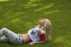 Lovely girl in meadow, background Stock Photo