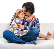Lovely girl and mother on sofa Royalty Free Stock Images