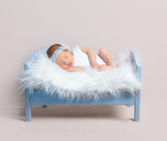 Lovely girl napping on wooden blue bed Royalty Free Stock Photo