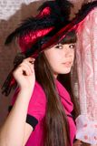 Lovely girl in pink dress and hat Stock Image