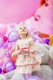 Lovely girl playing in game room of balloons Royalty Free Stock Images