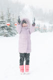 A lovely girl playing snow Stock Images