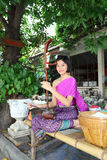 The lovely girl playing Thai ancient musical instr Royalty Free Stock Images