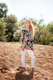 Lovely girl posing in casual clothes on beach Royalty Free Stock Images