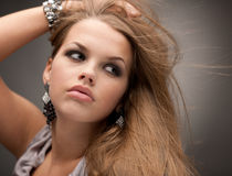 Lovely Girl Posing With Jewelry Royalty Free Stock Photography