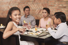 Lovely girl. Lovely pretty girl sitting at dinner table and looking at camera Stock Image