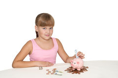 Lovely girl putting money in piggy bank isolated Royalty Free Stock Photography