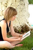 Lovely girl reading the book Royalty Free Stock Photo