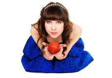 Lovely girl with a red apple Royalty Free Stock Photography