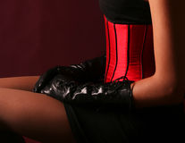 Lovely girl in red corset Royalty Free Stock Images