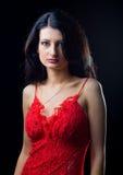 Lovely girl in red dress Stock Photos