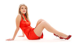 Lovely girl in red dress Royalty Free Stock Images
