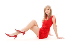 Lovely girl in red dress Stock Images