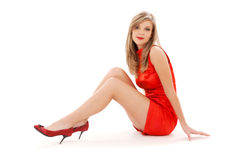 Lovely girl in red dress Stock Photography