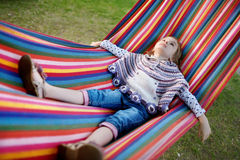 Lovely girl resting in a hammock Royalty Free Stock Photo