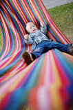 Lovely girl resting in a hammock Royalty Free Stock Images