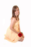 Lovely girl with rose kneeling. Royalty Free Stock Photo