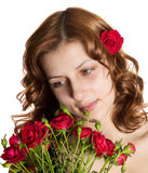 Lovely girl with roses Royalty Free Stock Images