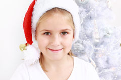 Lovely girl with Santa hat Stock Image