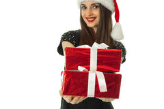 Lovely girl in santa hat with red gift. Box in hands smiling isolated on white background Royalty Free Stock Photo