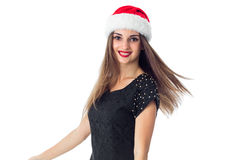 Lovely girl in santa hat. Smiling on camera isolated on white background Stock Images