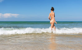 Lovely girl in sea on sunny day Stock Photos
