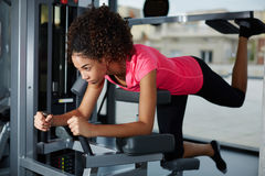 Lovely girl shakes her legs in the gym Stock Photos