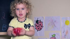 Lovely girl shaking piggy bank with coins in it. Static closeup shot. 4K JUHD stock footage