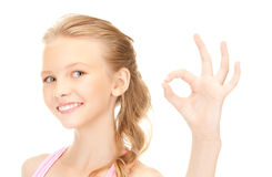 Lovely girl showing ok sign Royalty Free Stock Images