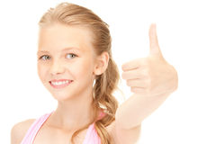 Lovely girl showing thumbs up sign Stock Photography