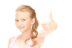 Lovely girl showing thumbs up sign Stock Images