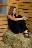 Lovely girl sitting on hay Royalty Free Stock Photos