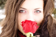 Lovely girl smelling rose, focus on flower Royalty Free Stock Image