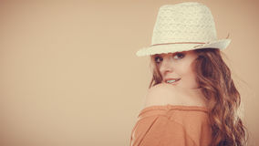 Lovely girl in summer clothes bright straw hat Stock Photo