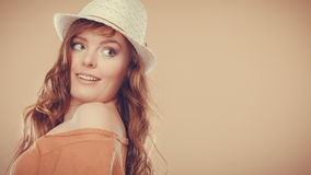 Lovely girl in summer clothes bright straw hat Stock Photography