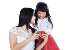 Lovely girl surprising her mother Royalty Free Stock Photo