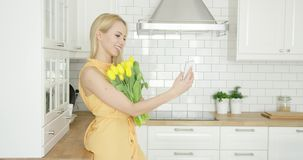 Lovely girl taking selfie with bouquet stock video footage