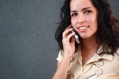Lovely girl talking on a cell phone. Lovely girl talking on a modern cell phone Stock Images