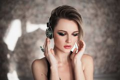 Lovely girl with tanned skin and white hair listening to music on headphones. royalty free stock photo